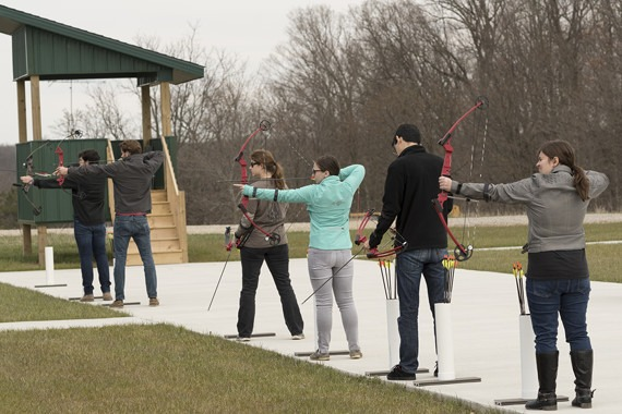 Several shooting sports members on the archery range.